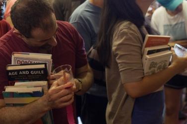 Member-supporters selecting their book premium thank you gifts - Libros Schmibros Aniversario 2013